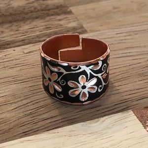Black and rose gold ring